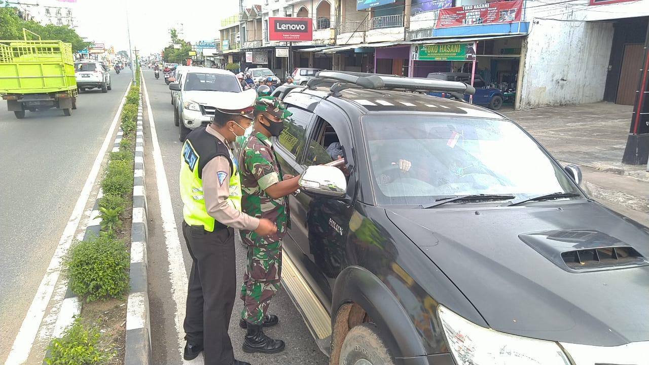 TNI - Polri Sinergi Sosialisasikan Pencegahan Virus Covid-19