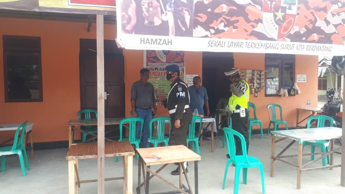 Cegah Penyebaran Virus Corona, TNI-Polri Bersinergi Himbau Masyarakat di Warung Kopi