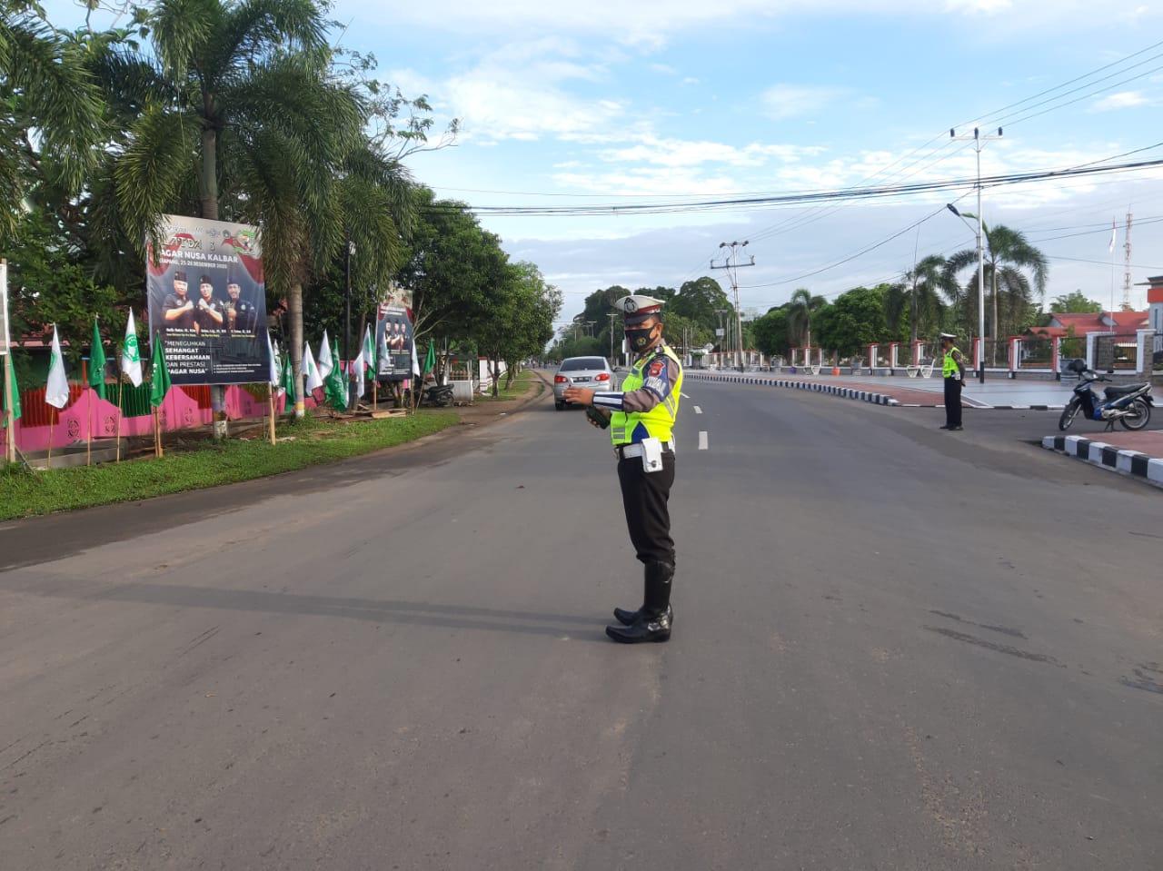 Pengaturan arus lalu lintas di pagi hari